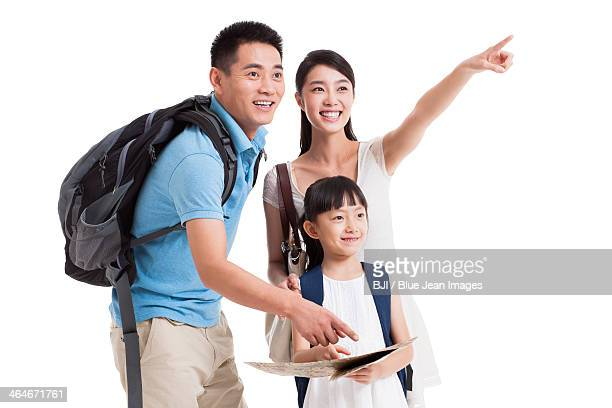 Young family in travel reading a map