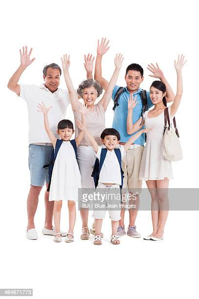 Young family in travel waving
