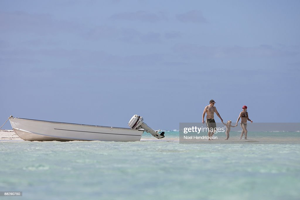 young family in tropical ocean : Stock Photo