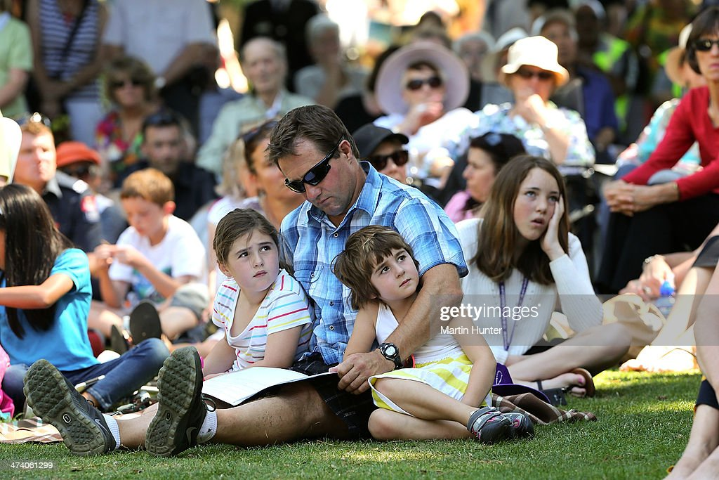 A young family listens to speeches during a Civic Memorial Service held in the Botanical Gardens for victims of the 2011 Christchurch Earthquakes on February 22, 2014 in Christchurch, New Zealand. The earthquake measuring 6.3 in magnistude devastated Christchurch killing 185 people and causing an estimated $40 billion in damage to the city's buildings and infrastructure.