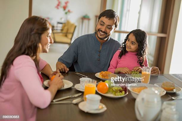 young family of three at dining table