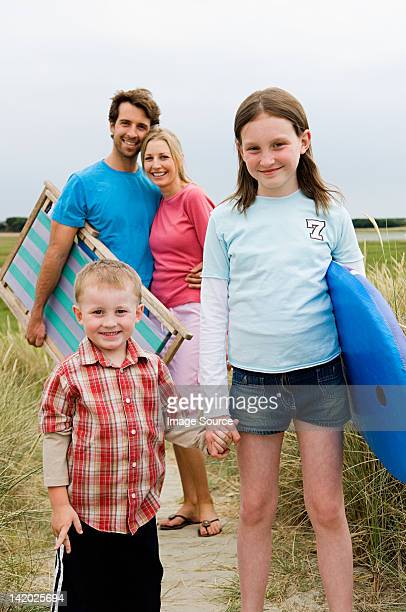 Young family on beach, portrait