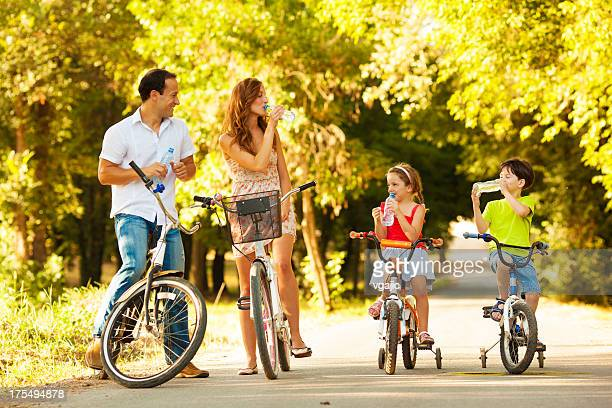 Young family on bicycles in park