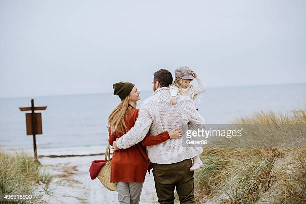 Young family on the beach