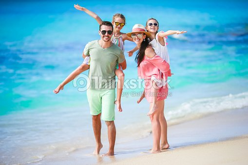Young family on vacation have a lot of fun together : Stock Photo
