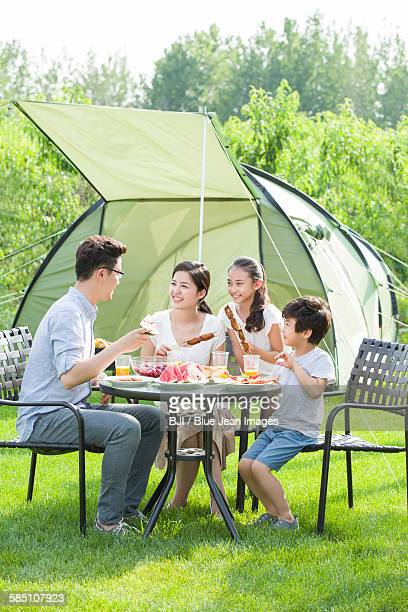 Young family picnicking outdoors
