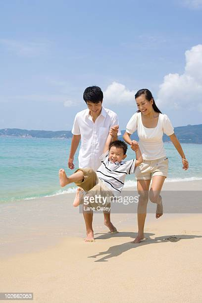 Young family playing on the beach