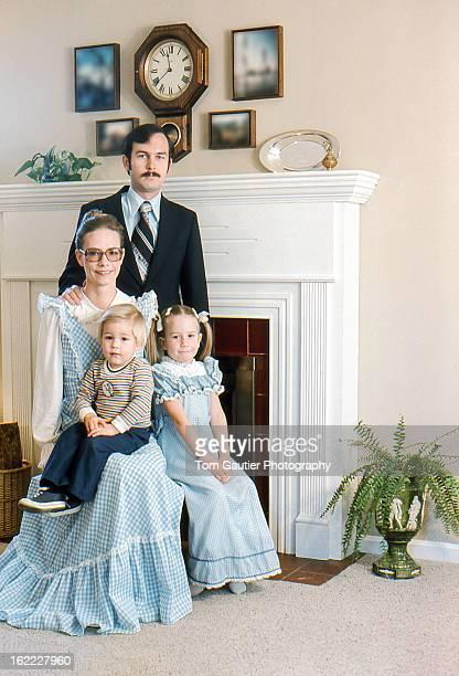 Young family posing for DIY Christmas card photo