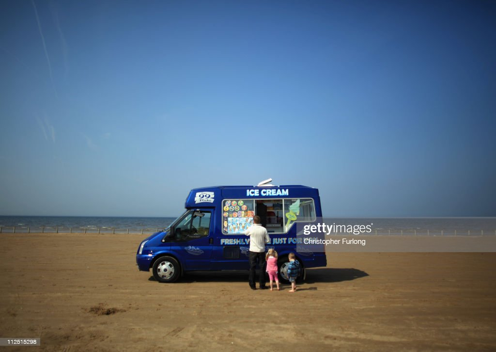 A young family queue for ice cream on Ainsdale beach on April 19, 2011 in Ainsdale, United Kingdom. Weather forecasters are predicting warm and sunny weather for the Easter holiday weekend with many Britons taking extra time off work to get an 11 day break by including the extra bank holiday for the wedding of Prince William and Catherine Middleton on April 29th.