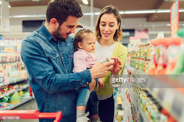 Young Family Shopping Groceries