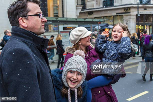 Young Family Sightseeing and Shopping at Christmas Markets