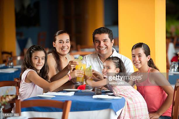 Young family sitting at a restaurant