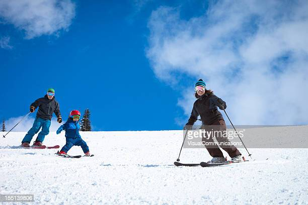 young family skiing.