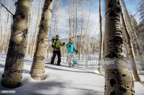 Young family snowshoeing