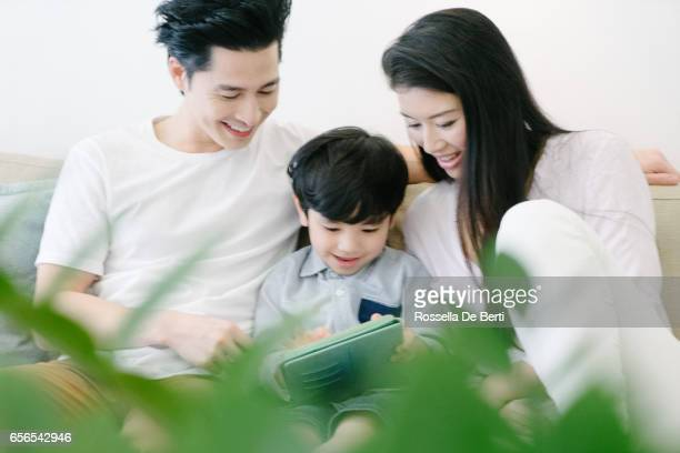 Young family using digital tablet