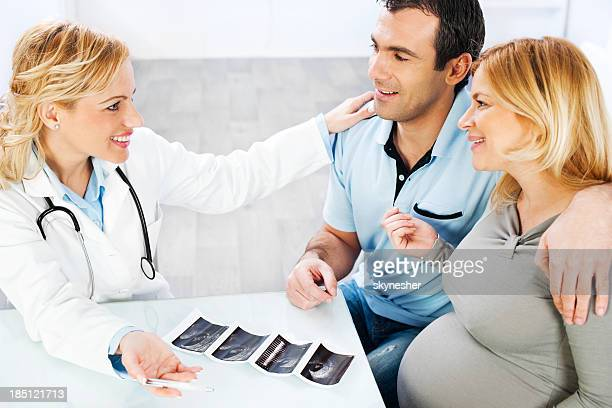 Young family visiting a doctor, looking at Ultrasound.