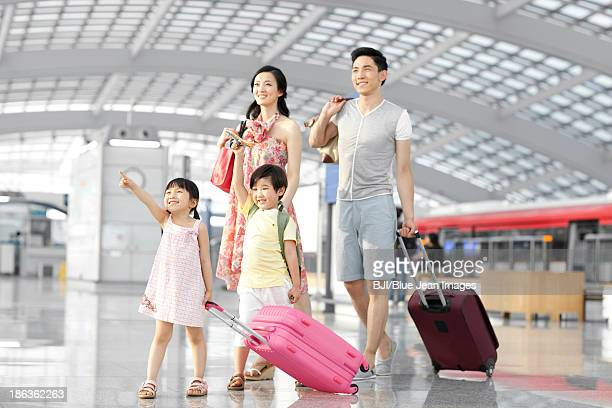Young family walking at the airport