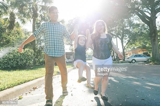 Young Family Walking in Winter Park Neighborhood Orlando Florida