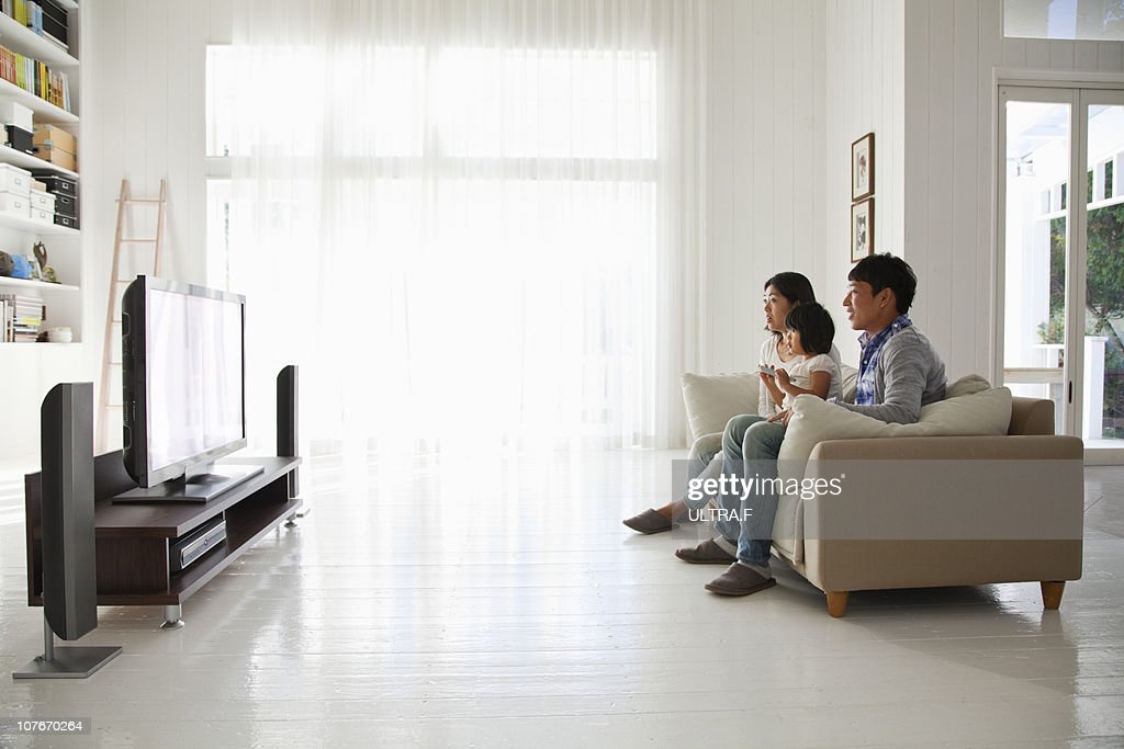 Young family watching TV : Stock Photo