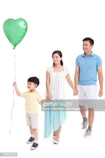 Young family with a heart-shaped balloon