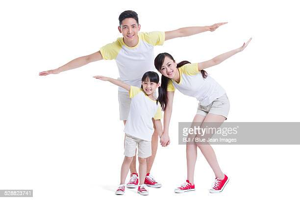 Young family with arms outstretched