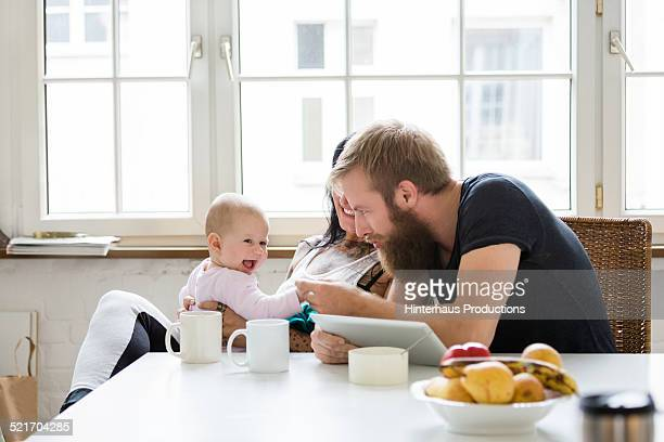 Young Family With Baby having Fun
