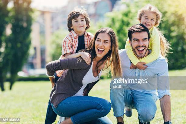 Young family with children playing in the park