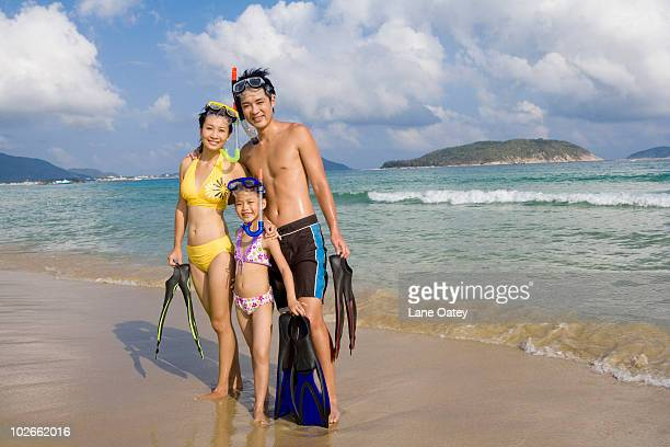Young family with snorkel gear
