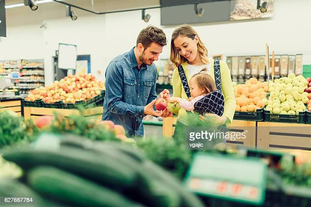 Young Family With Their Baby Daughter Groceries Shopping