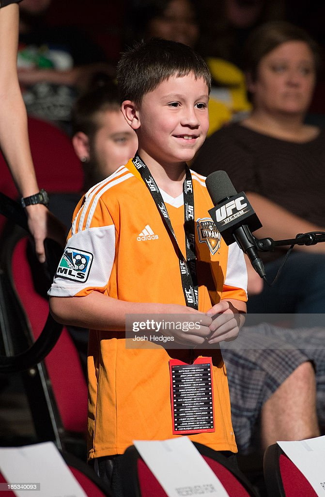 A young fan asks a question of UFC featherweight Chad Mendes (not pictured) during a Q&A session before the UFC 166 weigh-in event at the Toyota Center on October 18, 2013 in Houston, Texas.