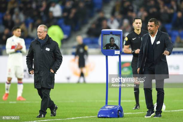 A young fan at the webcam of the OL Fondation with Bernard Lacombe and Sonny Anderson during the Ligue 1 match between Olympique Lyonnais and...