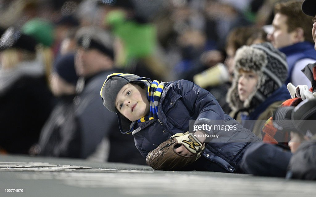 A young fan bundles up as temperatures approached freezing during the Chicago White Sox Seattle Mariners game on April 5, 2012 at U.S. Cellular Field in Chicago, Illinois.