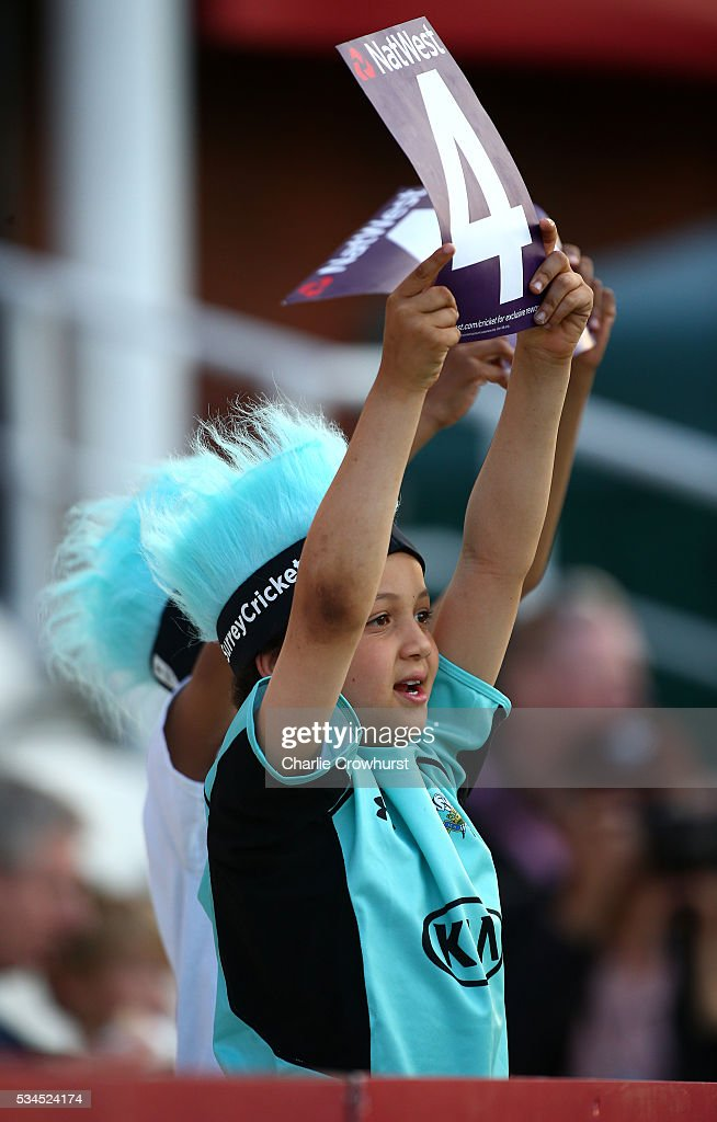 A young fan celebrates a boundary during the Natwest T20 Blast match between Surrey and Glamorgan at The Kia Oval on May 26, 2016 in London, England.