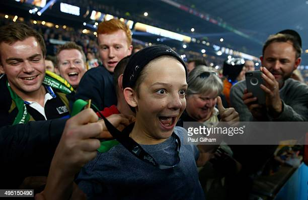 Young fan Charlie Lines is all smiles after being given the winning medal of Sonny Bill Williams of New Zealand after the 2015 Rugby World Cup Final...