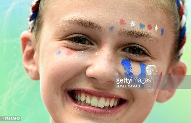 A young fan cheers as she waits for the start of the Group D match of the 2015 FIFA Women's World Cup between the USA and Australia at the Winnipeg...