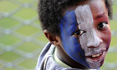 A young fan cheers at France's rugby union national team during a training session on March 18 2009 in Marcoussis south of Paris three days before...