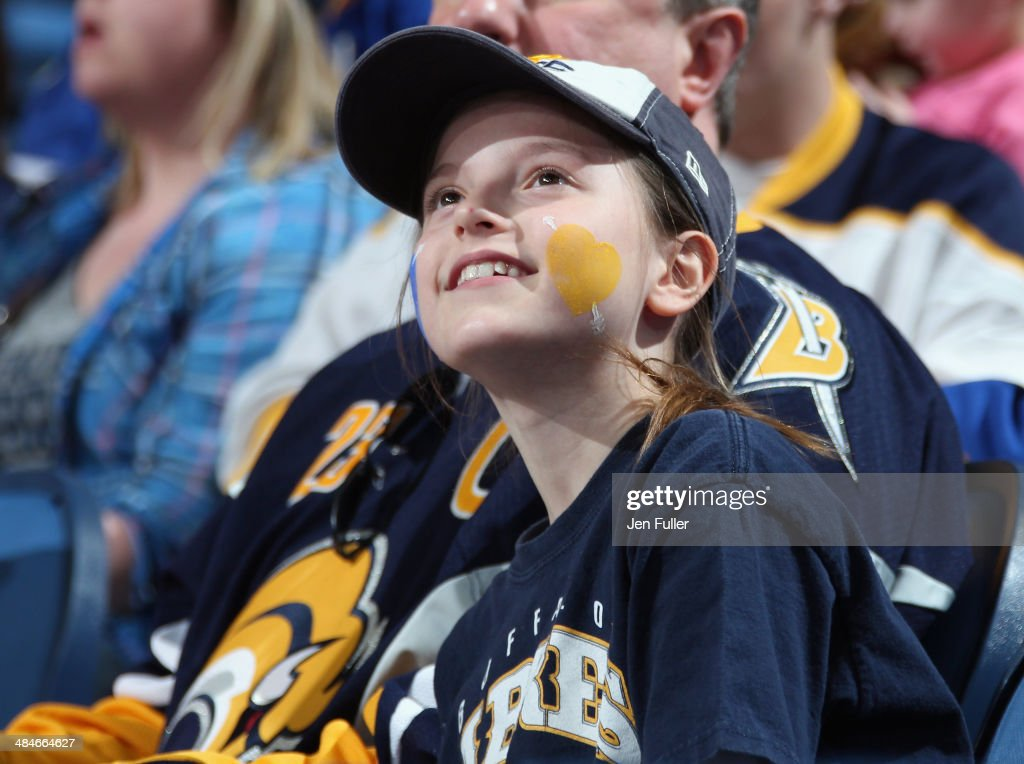 A young fan cheers for the Buffalo Sabres in their game against the New York Islanders during Fan Appreciation Night at First Niagara Center on April 13, 2014 in Buffalo, New York. New York defeated Buffalo 4-3.