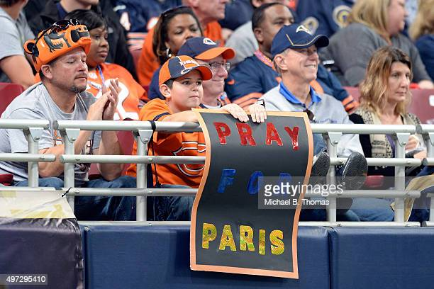 A young fan displays a sign in support for the people of Paris France during the second half of a football game between the Chicago Bears and the St...