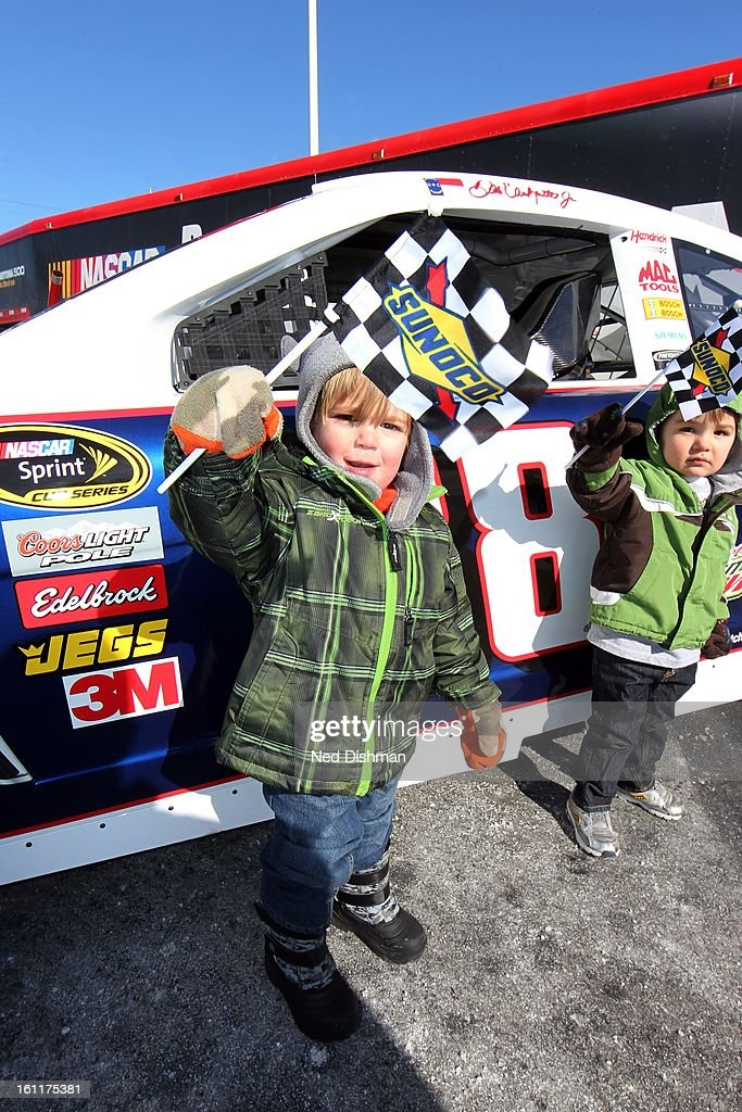 A young fan displays giveaways during a Road to Daytona Fueled By Sunoco Tour stop at the Sunoco Station on February 9, 2013 in Newark, Delaware.