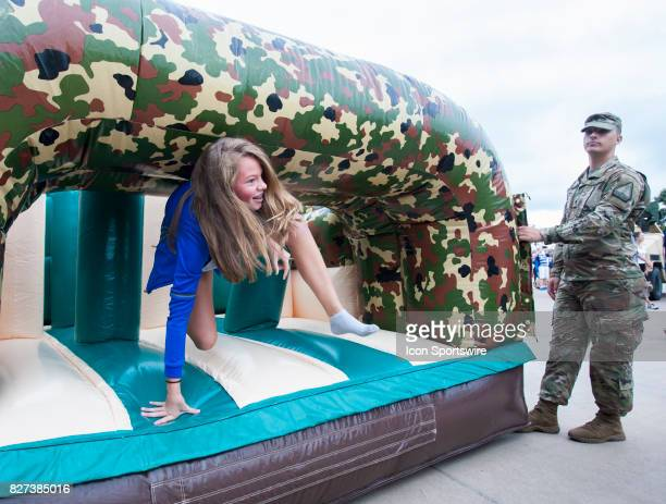 A young fan emerges from an inflatable obstacle course during Military Appreciation day before the match between Sporting Kansas City and Atlanta...
