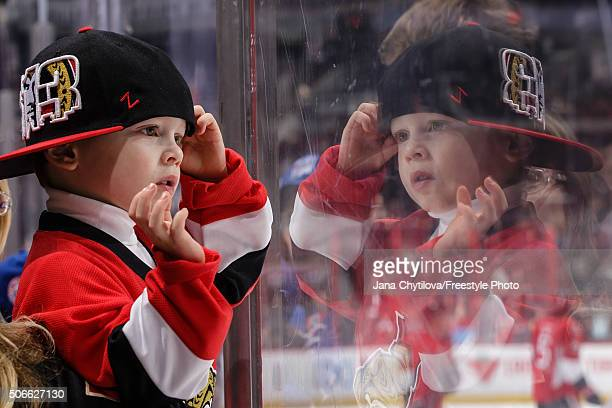A young fan enjoys the pregame skate prior to the start of a game between the Ottawa Senators and the New York Rangers during an NHL game at Canadian...