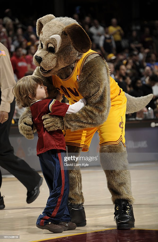 A young fan gives Cleveland Cavaliers' mascot Moondog a hug during a break in the action against the Denver Nuggets at The Quicken Loans Arena on February 9, 2013 in Cleveland, Ohio.