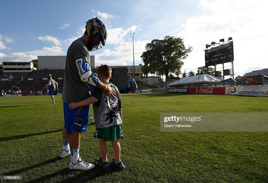 A young fan greets Joey Sankey of the Charlotte Hounds as he warms up before their game against the Ohio Machine at American Legion Memorial Stadium...