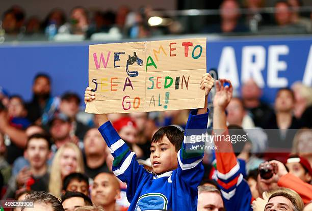 A young fan has a message for the Vancouver Canucks during their NHL game against the Edmonton Oilers at Rogers Arena October 18 2015 in Vancouver...