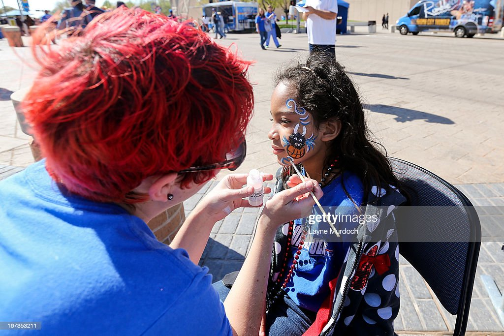 A young fan has her face painted before the Houston Rockets played the Oklahoma City Thunder in Game Two of the Western Conference Quarterfinals during the 2013 NBA Playoffs on April 24, 2013 at the Chesapeake Energy Arena in Oklahoma City, Oklahoma.