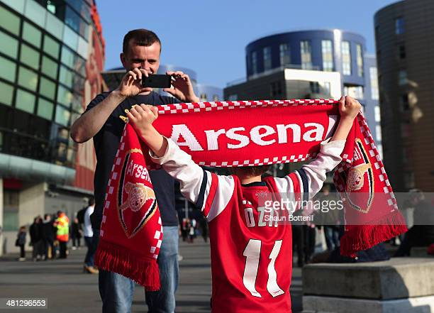 A young fan has his picture taken before the Barclays Premier League match between Arsenal and Manchester City at Emirates Stadium on March 29 2014...