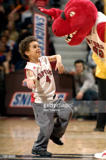 A young fan has some fun with the Raptor during a game between the Philadelphia 76ers and the Toronto Raptors on April 18 2007 at the Air Canada...