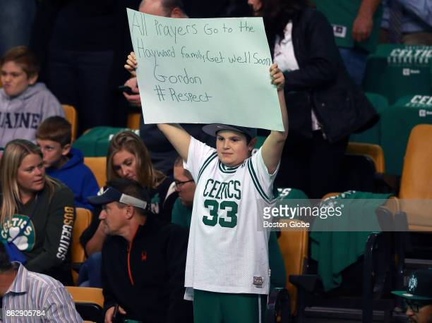 A young fan holds a sign expressing support for Boston Celtics forward Gordon Hayward who was injured in the team's seasonopening game in Cleveland...