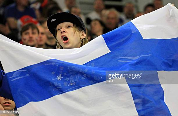 A young fan holds the Finish flag during the ice hockey match SwedenFinland at the Czech hockey games the last of the four Euro Hockey Tour...