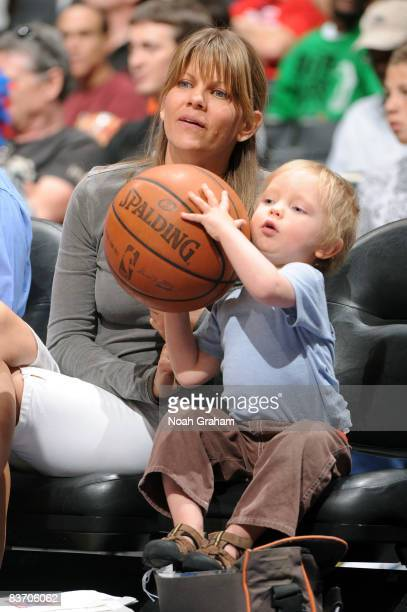 A young fan holds the game ball during a break in the action of the game between the Golden State Warriors and the Los Angeles Clippers at Staples...